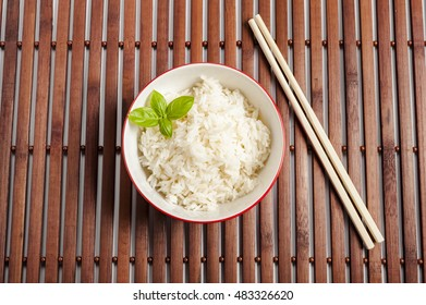 a bowl of rice on a white background