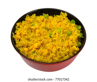 Bowl of rice with peas and corn. Isolated on white background.