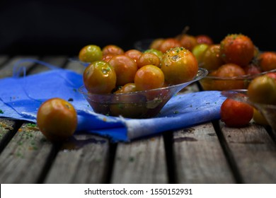 bowl with ripe small tomatoes seasoned with culinary herbs and olive oil