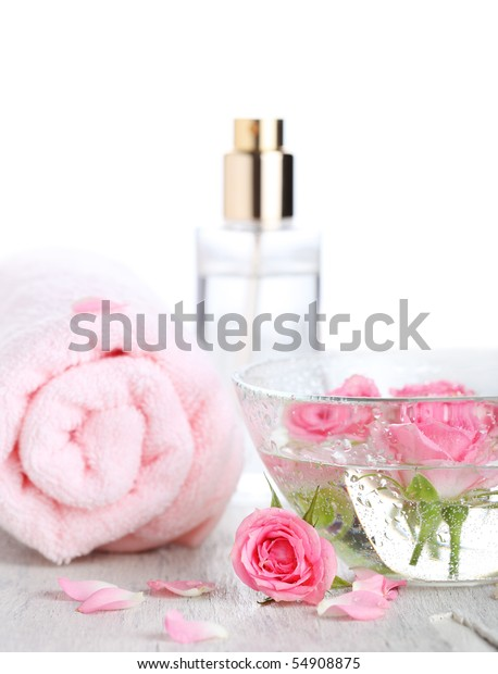 Bowl of roses, a towel and spa product