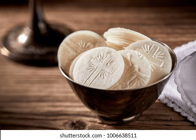 Bowl of sacramental Hosties ready for the Holy Communion service in a church representing the body of the resurrected Christ