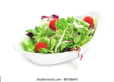 a bowl with salad with cherry tomatoes