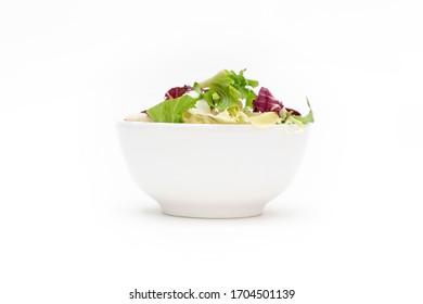 Bowl of salad on white background