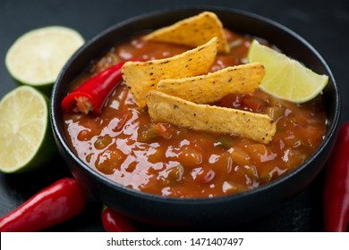 Bowl of salsa sauce with nachos chips, closeup, selective focus, horizontal shot