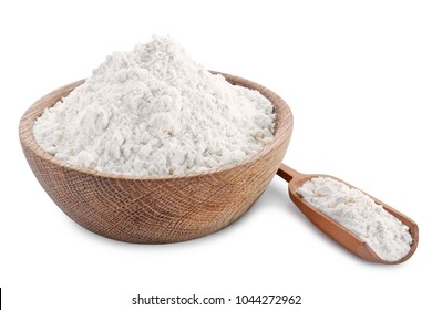 Bowl and scoop of wheat flour on white background