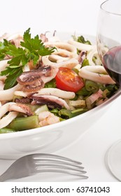 a bowl of seafood salad on a white background