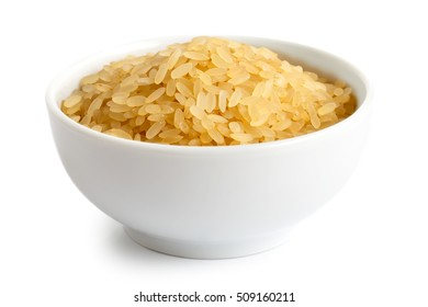 Bowl of short grain parboiled rice isolated on white.