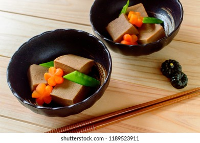 a bowl of simmered freeze dried tofu (koya tofu)with light soy sauce based broth