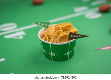 bowl of snacks for superbowl party on green table runner