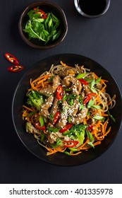 Bowl of soba noodles with beef and vegetables. Asian food. Top view.