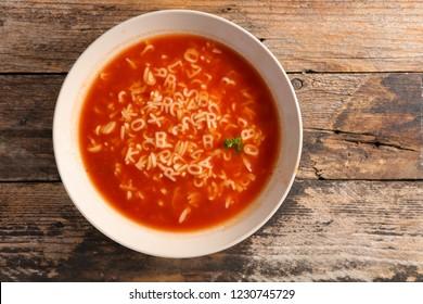 bowl of soup and alphabet noodles