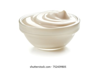 Bowl of sour cream, isolated on white background.