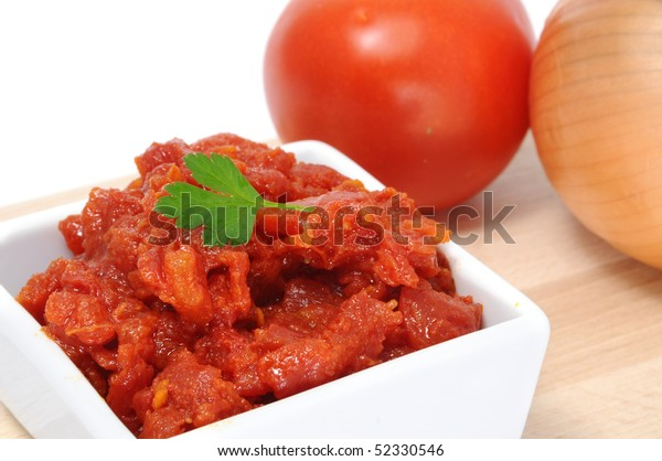 a bowl of spanish sofrito, made with tomatoes, onion and garlic
