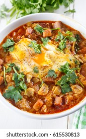 Bowl of Spicy Spanish Garlic and Bread Soup with Ham and Poached Egg