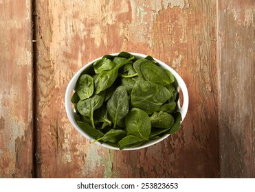 Bowl of spinach on wood