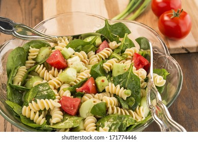 Bowl of spinach and rotini pasta salad