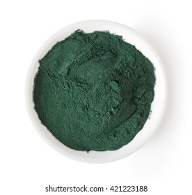 Bowl of spirulina powder isolated on white background, top view