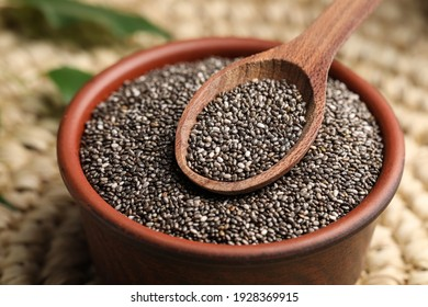 Bowl and spoon with chia seeds, closeup