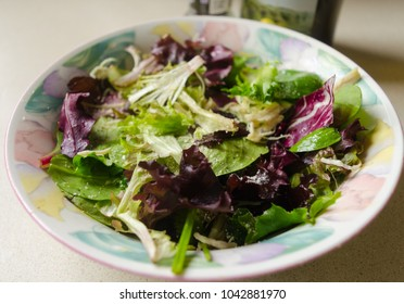 A bowl with spring mix salad