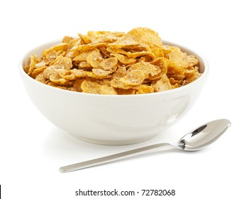 bowl of sugar-coated corn flakes and spoon isolated on white