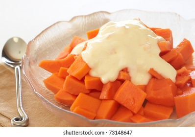 Bowl of summer papaya fruit salad with topping of fresh yoghurt