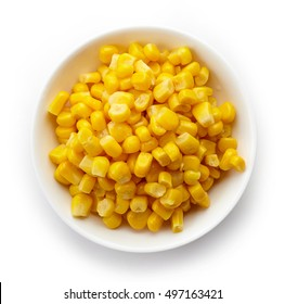 Bowl of sweet corn isolated on white background, top view
