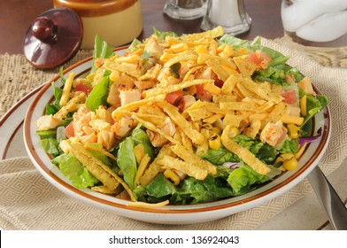 A bowl of taco salad with chicken and cheese