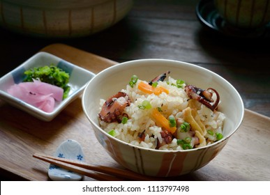 a bowl of tako takikomi gohan.  Takikomi gohan is a Japanese rice dish seasoned with dashi and soy sauce along with vegetables