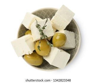 Bowl with tasty feta cheese and olives on white background