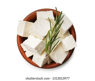 Bowl with tasty feta cheese on white background