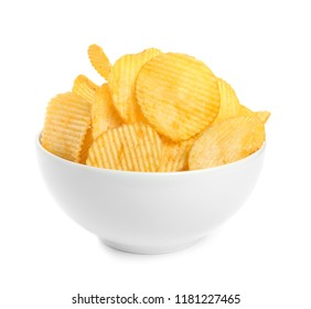 Bowl of tasty ridged potato chips on white background