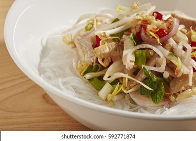 a bowl of Thai Noodle Salad made with chicken and mung bean threads