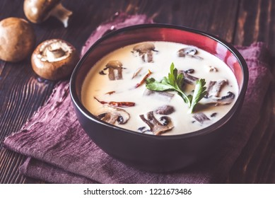 Bowl of thai tom kha soup on the wooden table