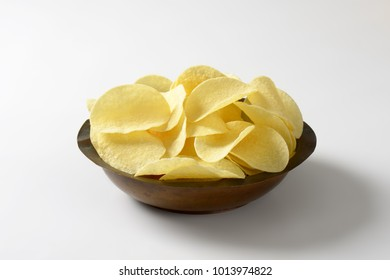 Bowl of thin salted potato chips (crisps)