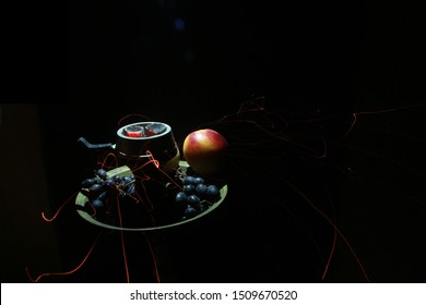 bowl with tobacco for hookah. berries on a black background