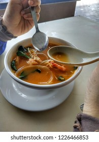 A bowl of Tom Yam Seafood, spicy Thai soup with mix of seafood can be eaten with rice.