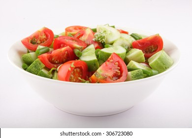 Bowl of Tomato and cucumber salad with  onion.