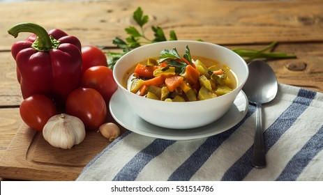 A bowl of traditional italian minestrone soup with ingredients