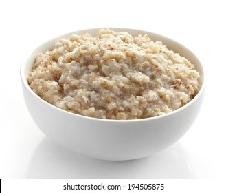 Bowl of various flakes porridge on white background