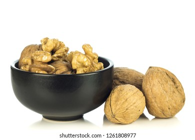 A bowl of walnuts on a white background with copy space for your text