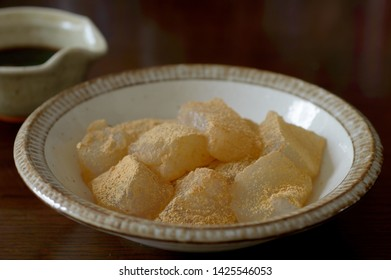 a bowl of warabi mochi on wooden table