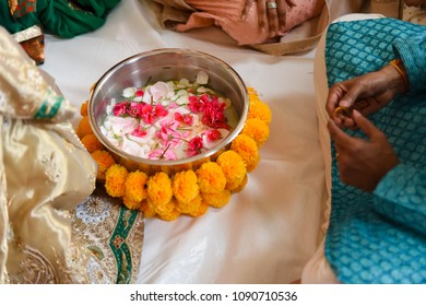 Bowl of water and flower petals for traditional Hindu wedding