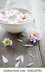 Bowl of water with pink flowers