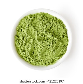 Bowl of wheat or barley grass powder isolated on white background, top view