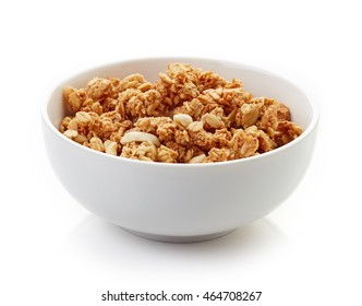 Bowl of whole grain muesli isolated on white background