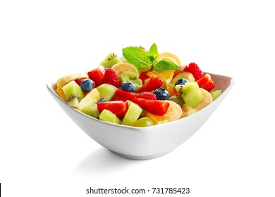 Bowl with yummy fruit salad, isolated on white
