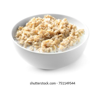 Bowl with yummy oatmeal against white background