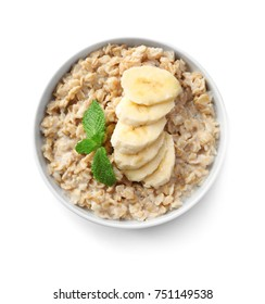Bowl with yummy oatmeal and banana against white background