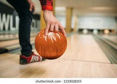 Bowler makes throw, closeup view on hand with ball