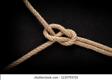 Bowline Knot on black background. Rope node